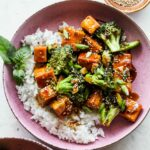 Teriyaki tofu and broccoli with rice and sesame seeds