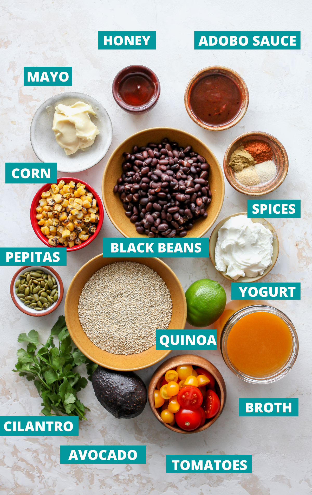 Recipe ingredients in bowls on a white board with blue title tags