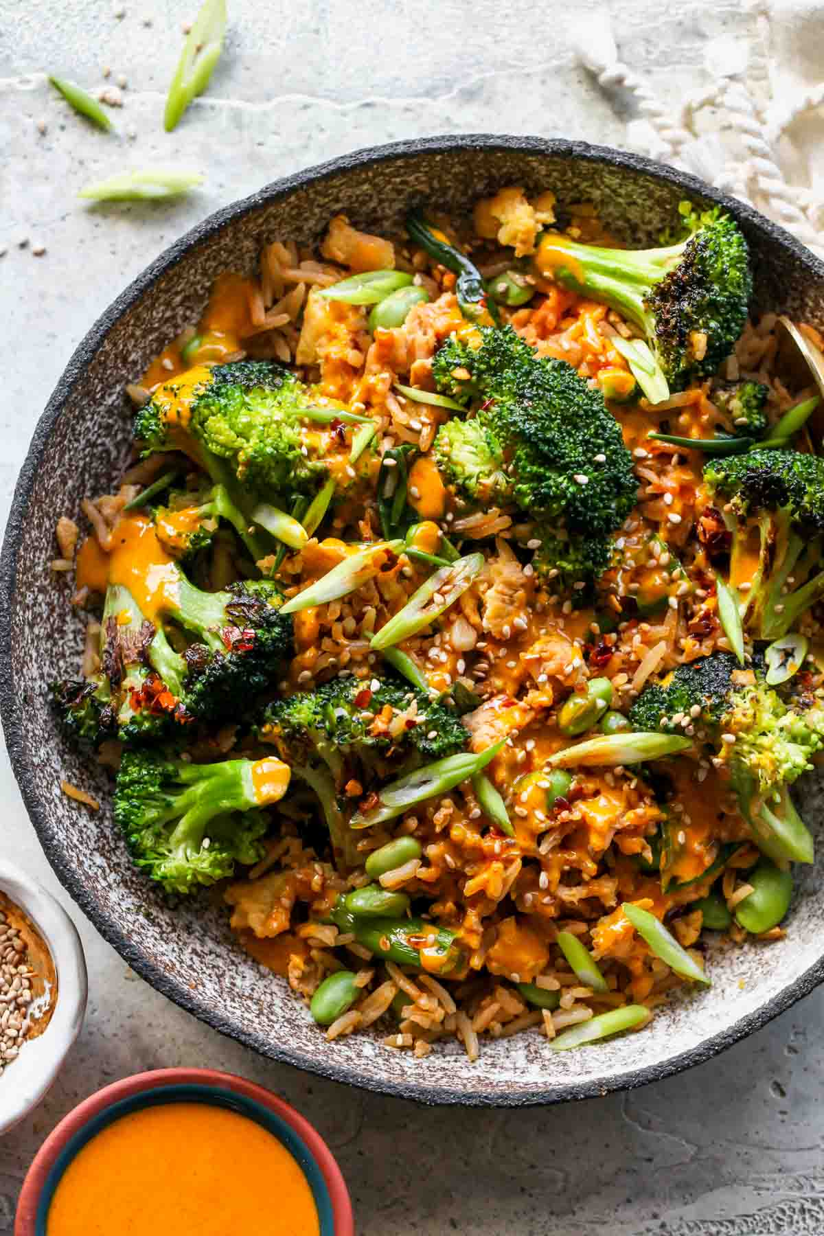 Broccoli, fried, rice, and sesame seeds in a bowl