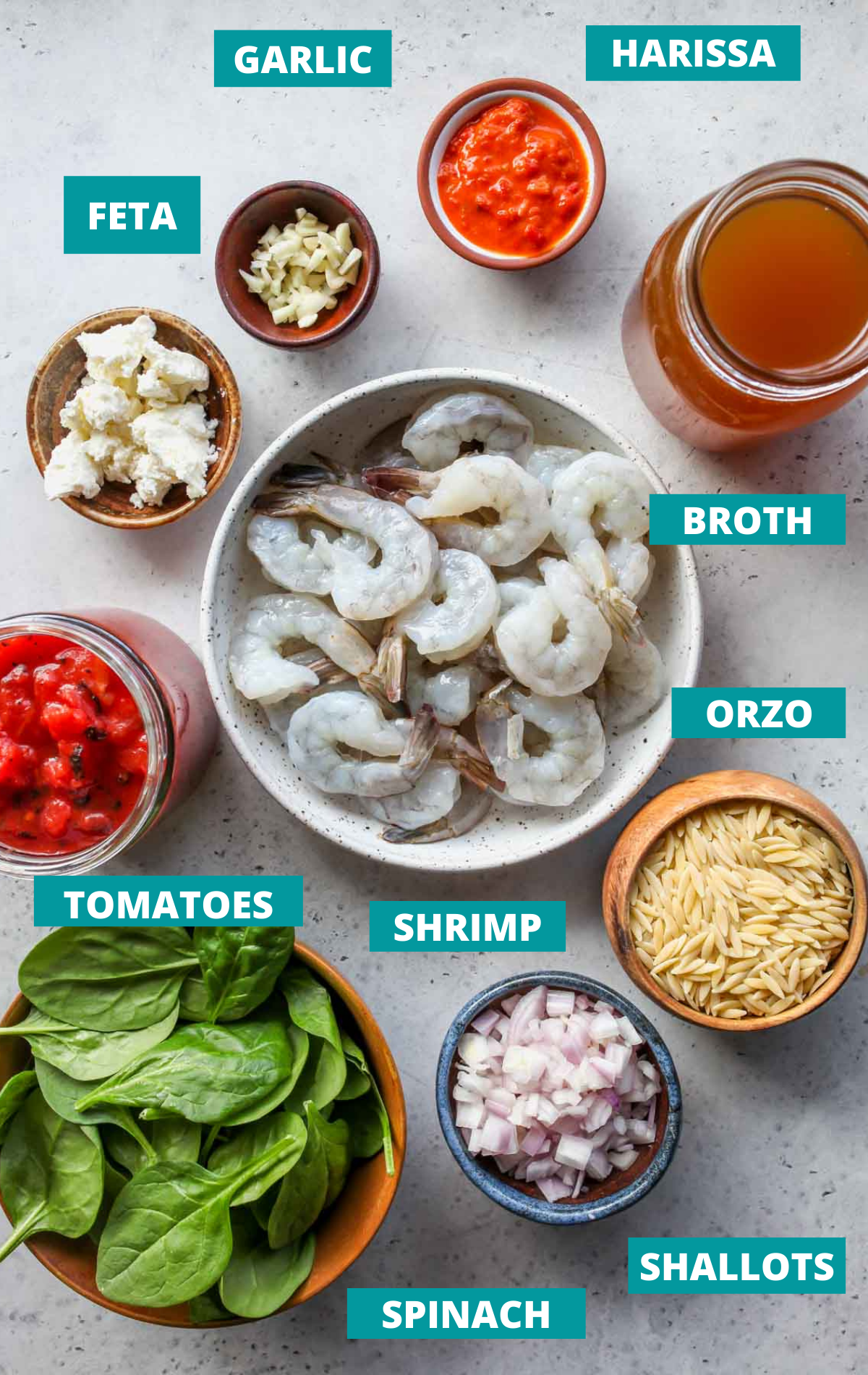 Recipe ingredients laid out on a board with blue labels