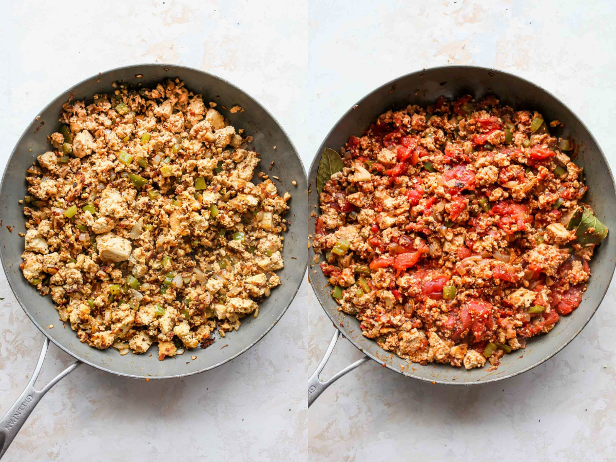 Tofu and tomatoes being added to a skillet over peppers and onions