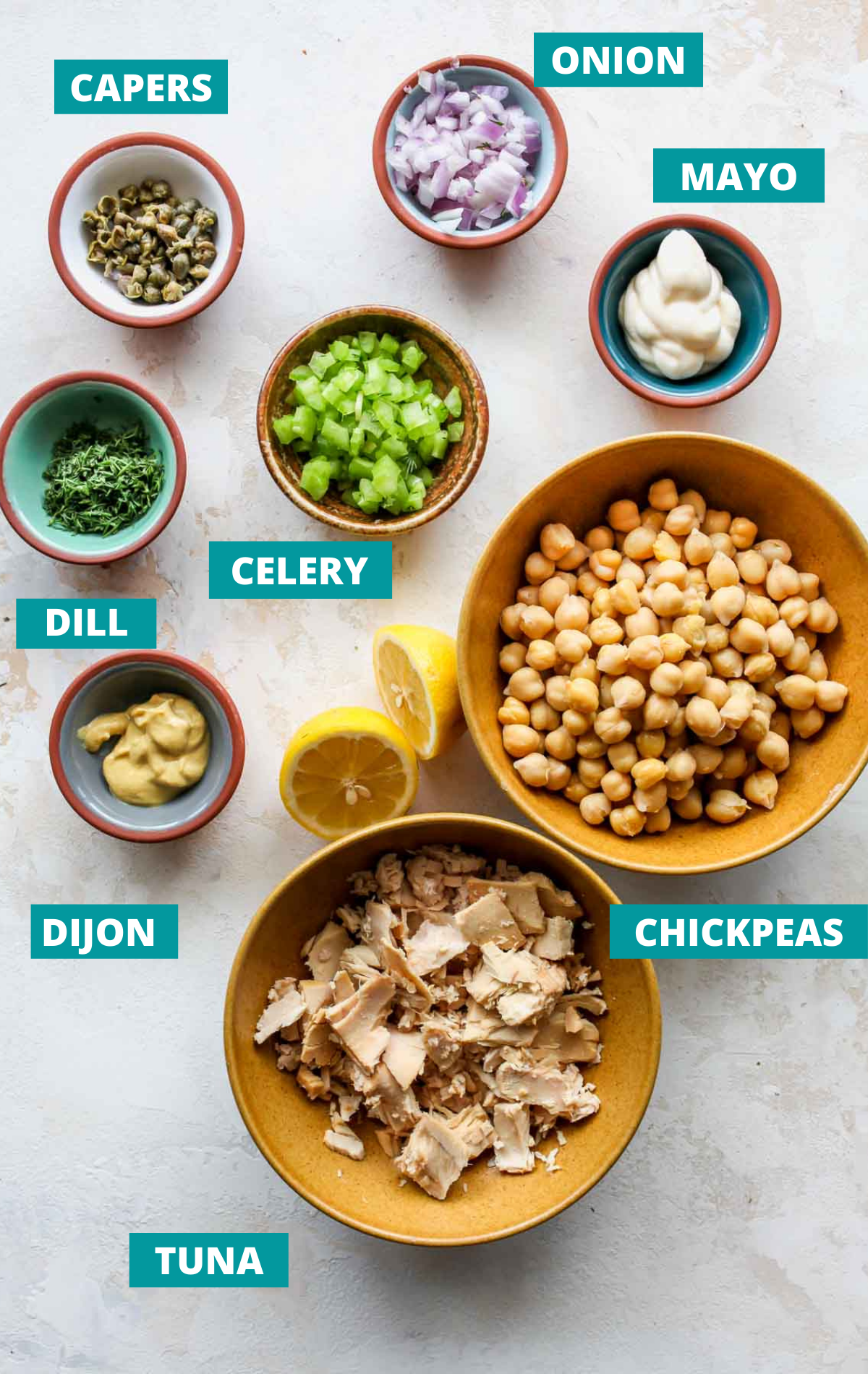 Recipe ingredients in separate bowls on a white board with green labels
