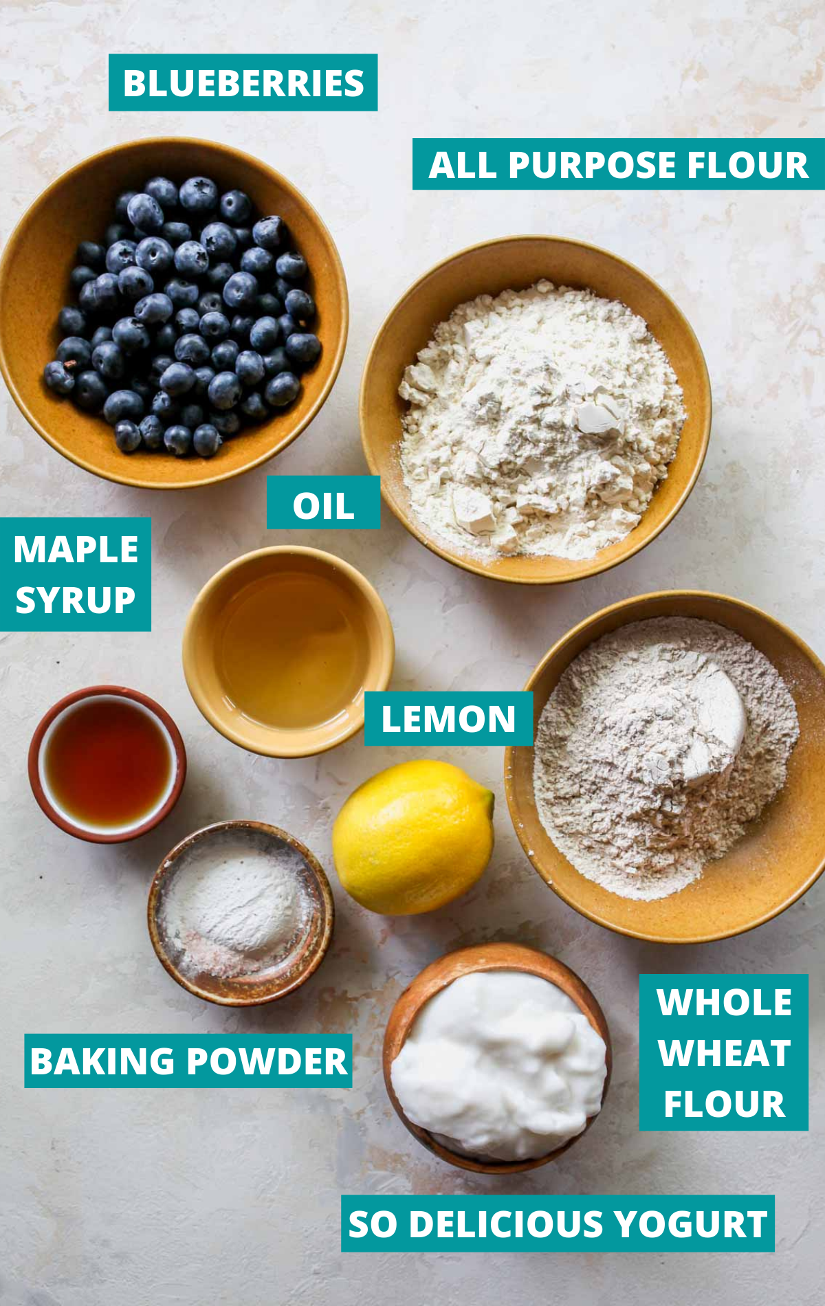 Recipe ingredients laid out in separate bowls with blue labels