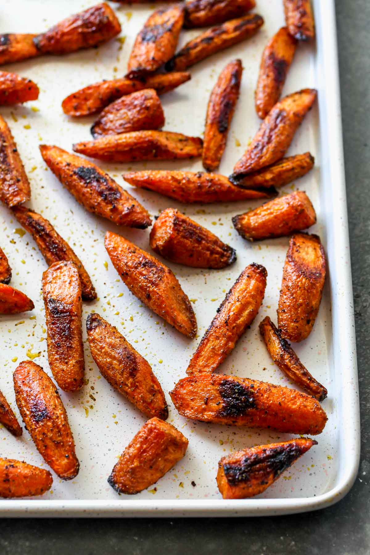 Roasted carrots on a white baking sheet