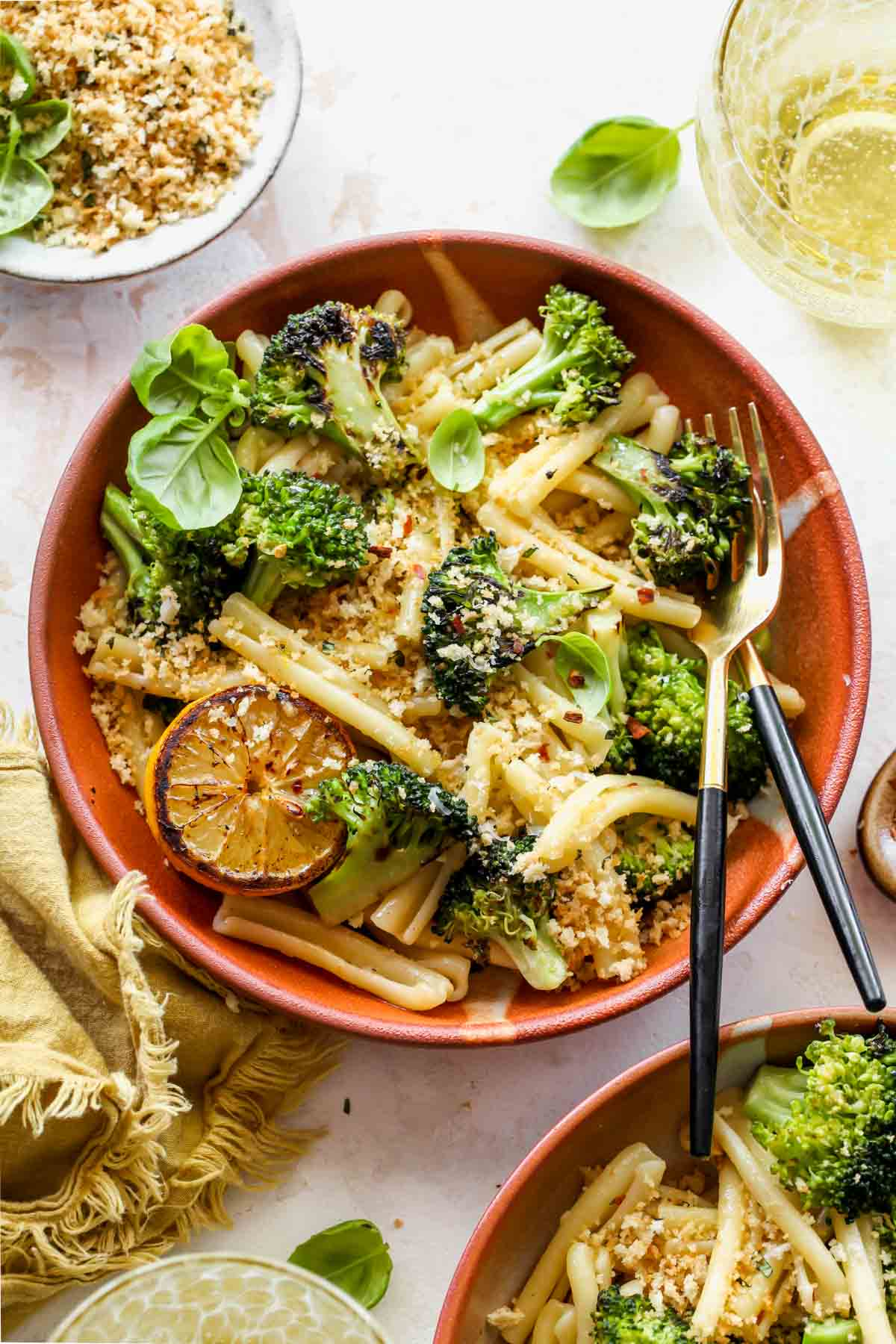 Broccoli pasta in a bowl topped with panko breadcrumbs