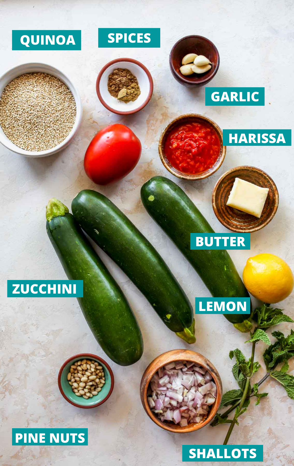 Stuffed zucchini ingredients in separate bowls with blue labels