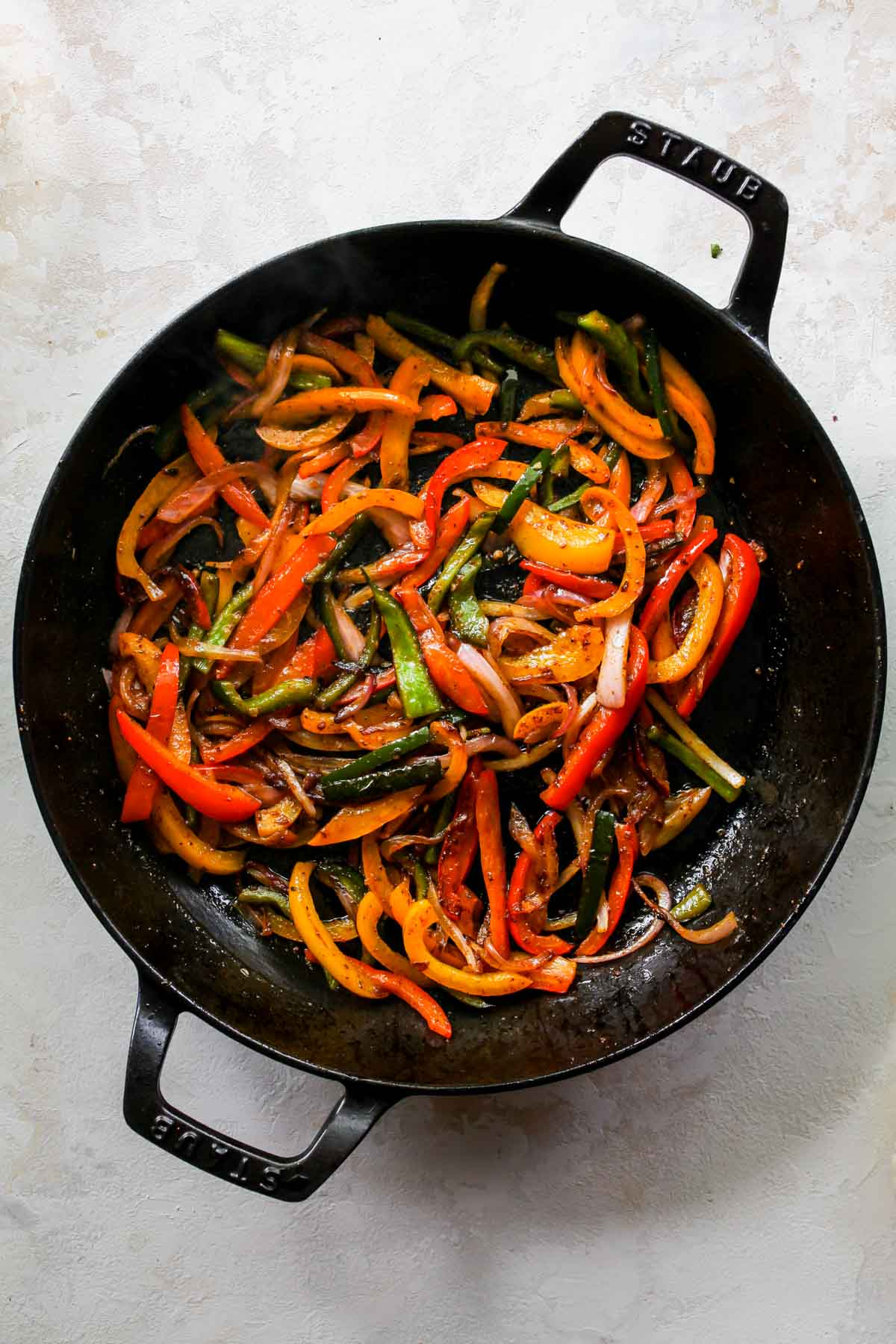 Fajita veggies in a black cast iron skillet