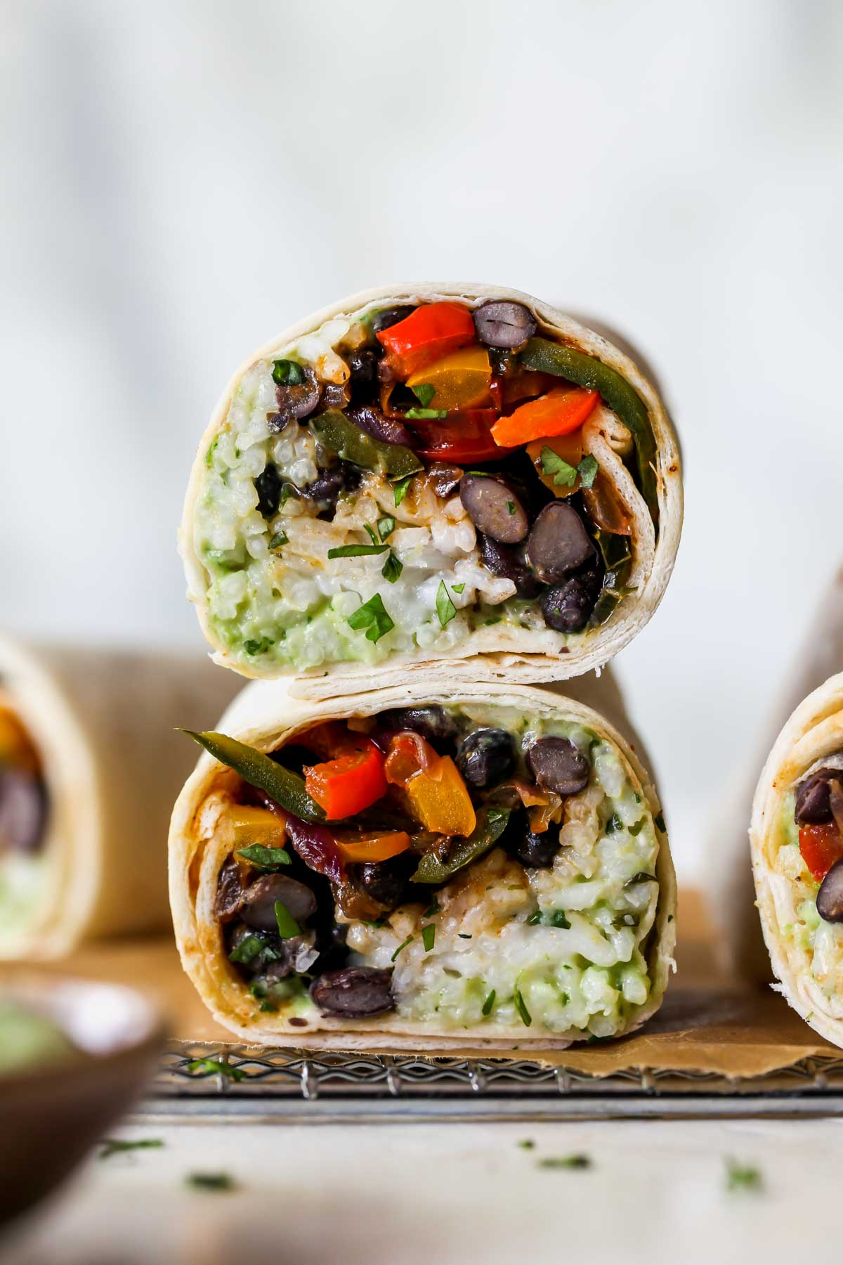 A stacked burrito on a serving platter