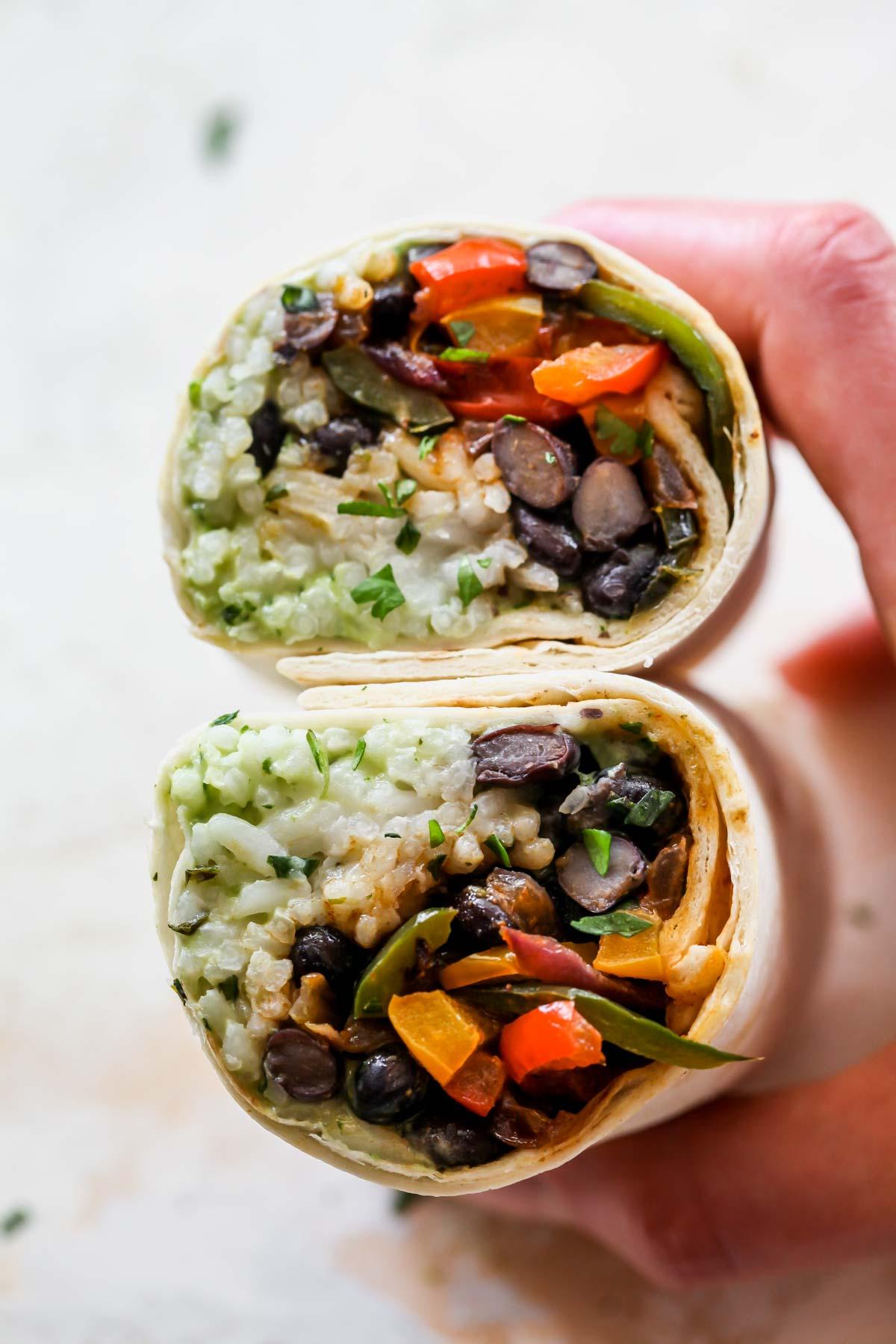 Vegetarian burrito sliced in half to see the fillings
