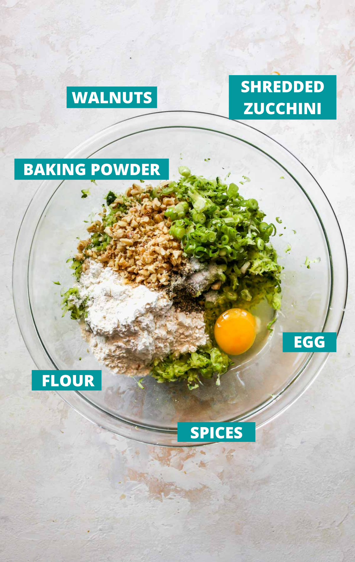 Fritter ingredients displayed in a bowl with blue labels