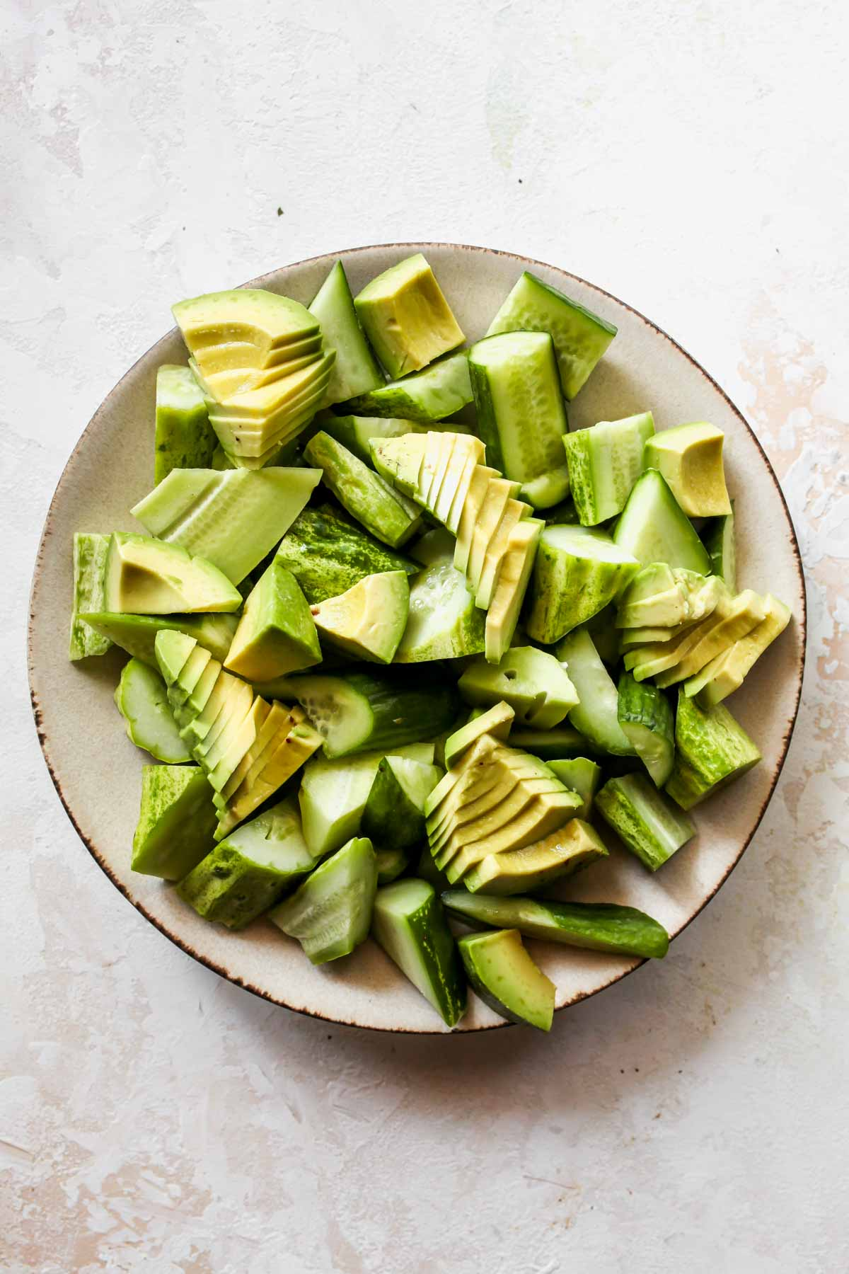 Cucumber and avocado slices arranged on a platter