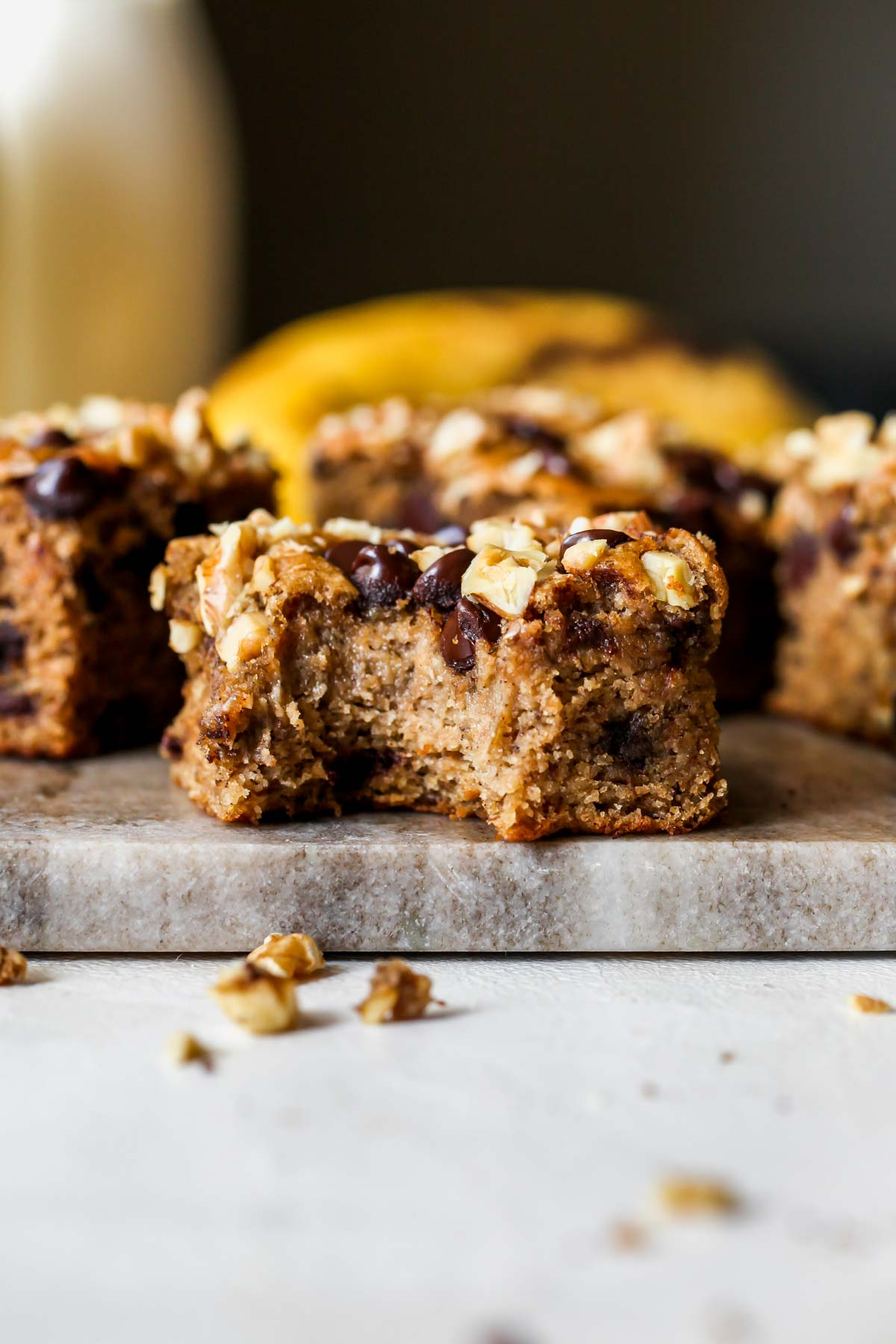 One banana bread bar with a bite taken out to show insides