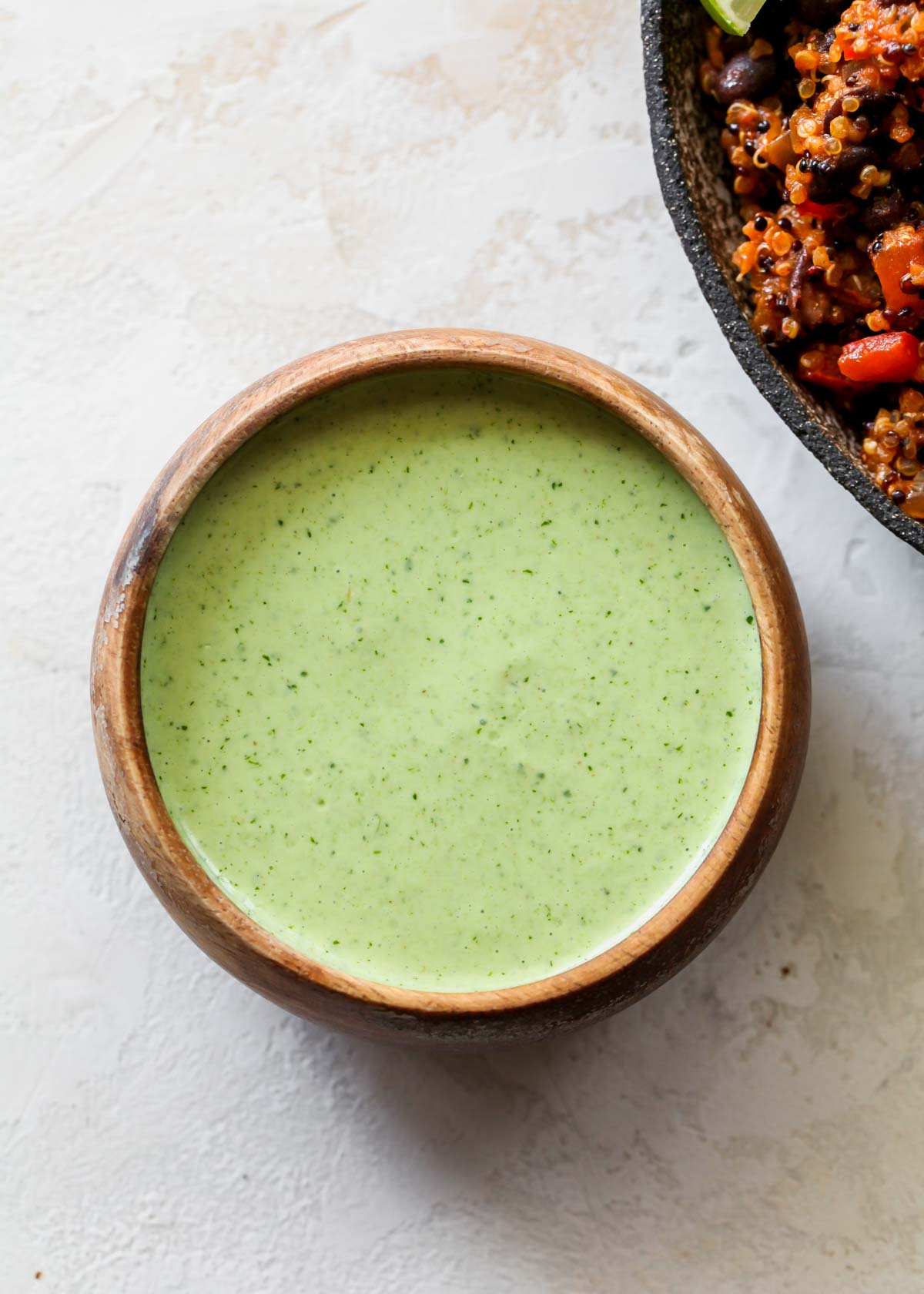 Cilantro-lime sauce in a small brown bowl