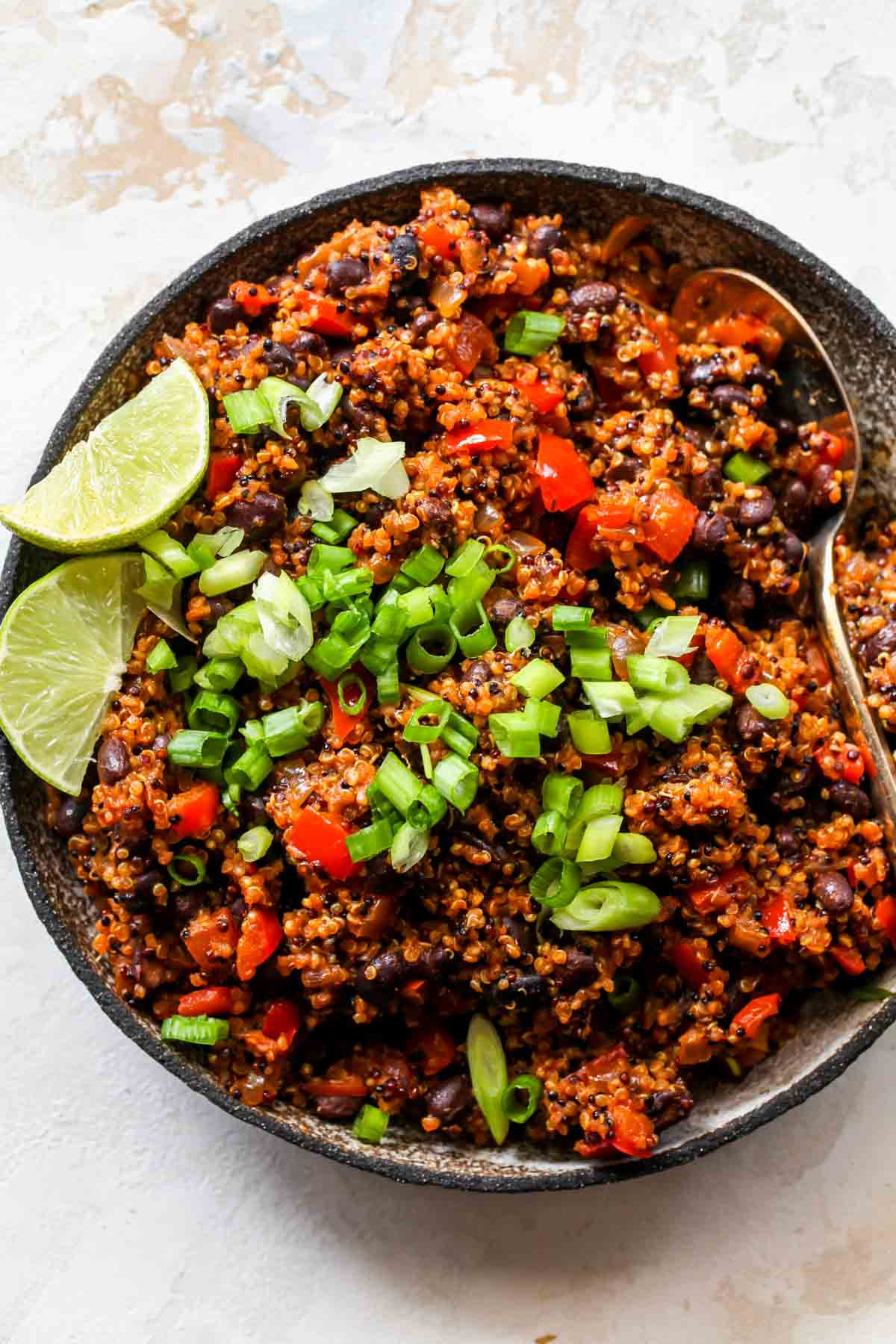 A silver bowl filled with taco-spiced quinoa taco filling