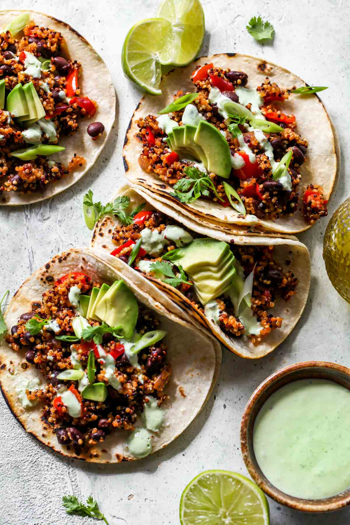 Quinoa tacos lined up in a row on a white board