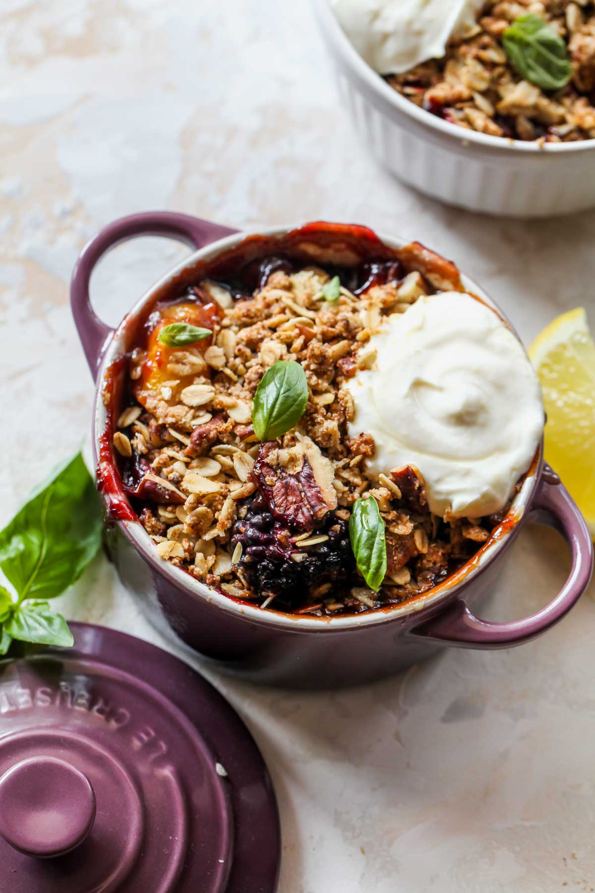 Peach fruit crisp topped with a dollop of yogurt