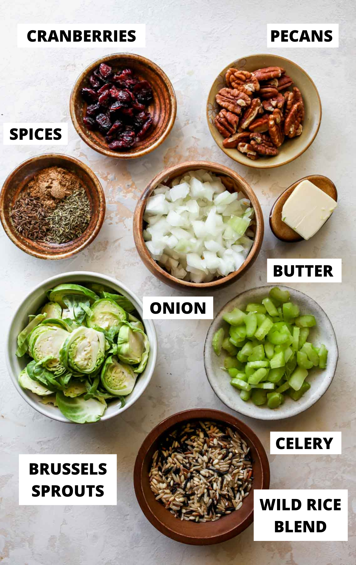 Pilaf ingredients in separate bowls on a white board with labels