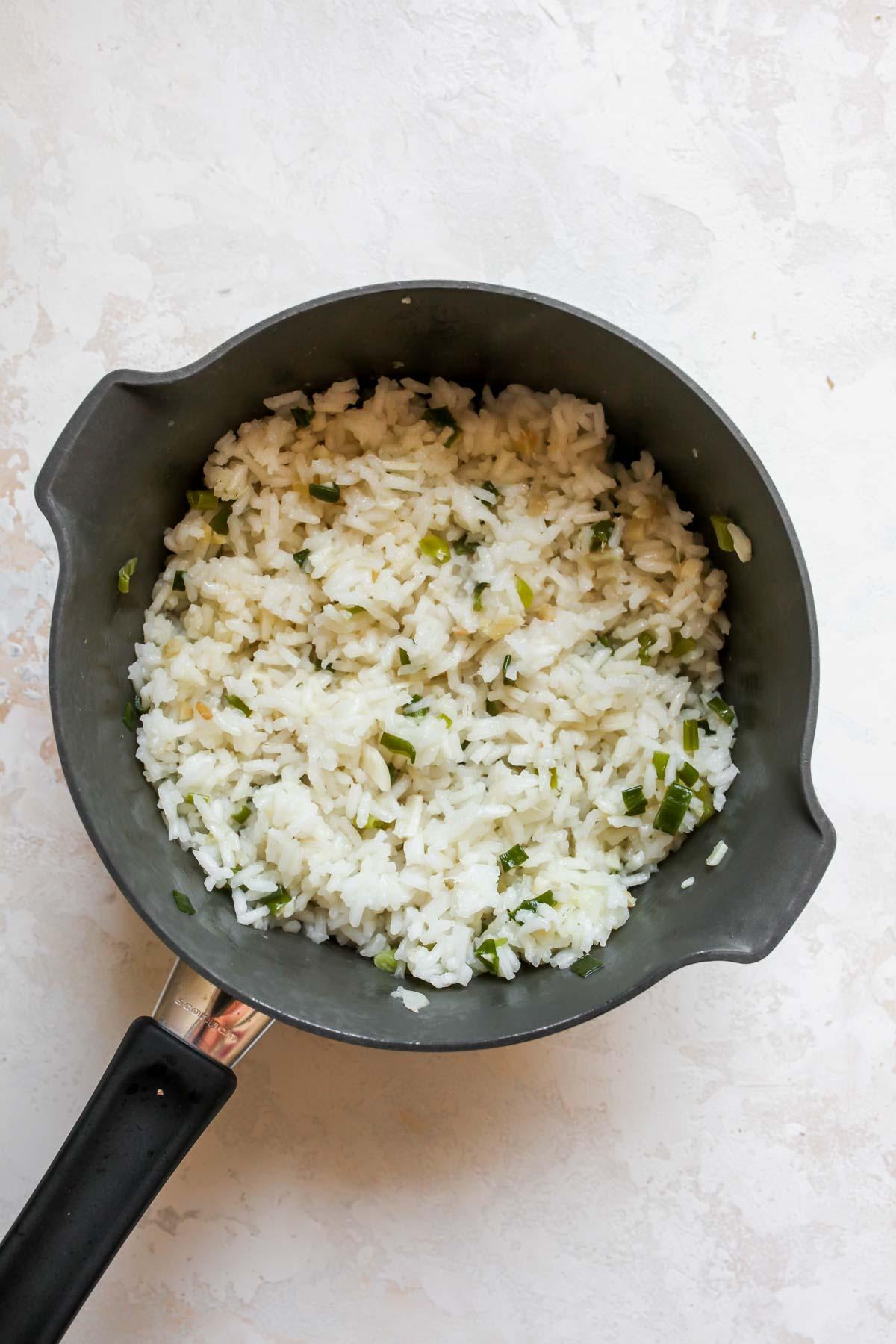 Ginger-scallion rice in a saucepan