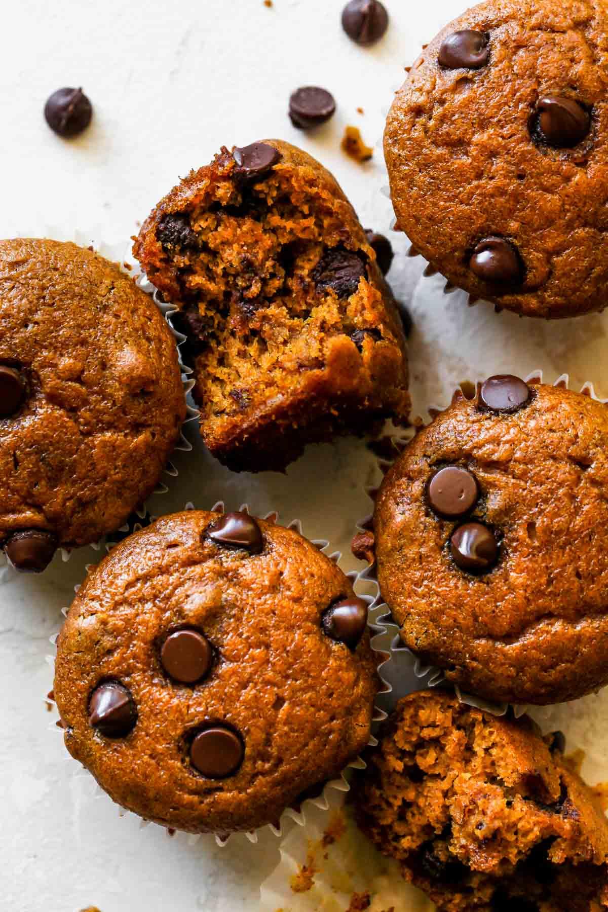 Pumpkin chocolate chip muffins on a white board