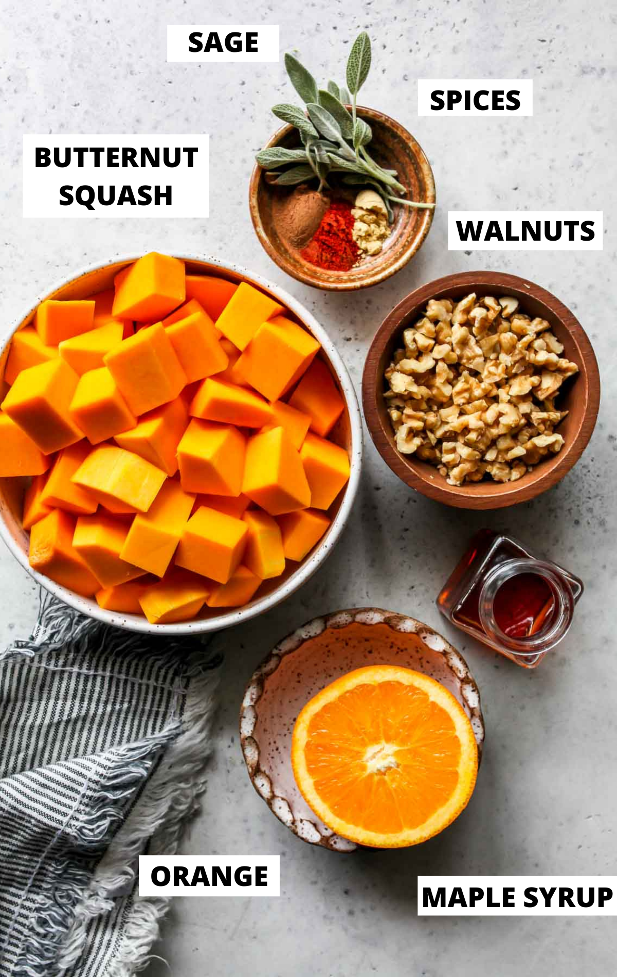 Recipe ingredients in separate bowls on a gray board with labels
